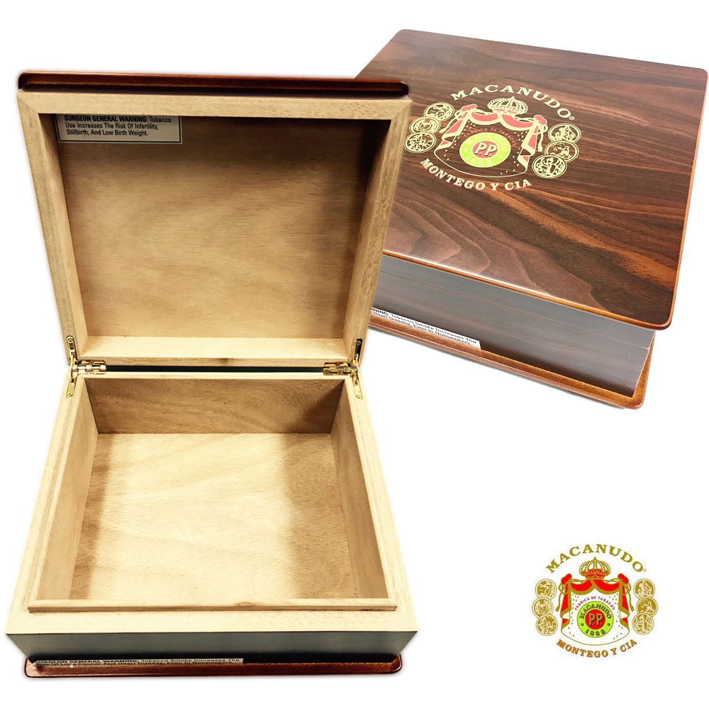 This uniquely styled Macanudo Humidor has a deep dark brown stain that enhances the wood and highlights the classic Macanudo Cigars logo on the lid. The humidor has solid brass hinges, comes with a basic humidifier, and has unique lid and base trim as you can see from the images. The base also has four feet that are covered in black felt to protect your table or desk surface. These elevate the humidor off the table top giving the unit an added elegance. Slightly annoying - by law Macanudo added the health warning sticker to the humidor, but it's easily removed. A small irritation. A work of art. Holds up to 50 cigars (depending on size) and makes for a beautiful centerpiece in your cigar den or lounge. Made of thick, solid wood and lined with premium Spanish cedar, this rare humidor is guaranteed to maintain the perfect, stable environment your most prized cigars need to properly age. Its heavy lid and thick cedar creates a true seal and seasons well. Regarding style, you'll love the